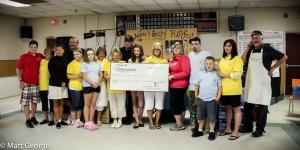 Andrea and Becky's Family Members hold a cheque for nearly $67 000 at then end of last year's Funfest